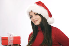 Young woman in a Santa Hat with a red gift box Royalty Free Stock Images