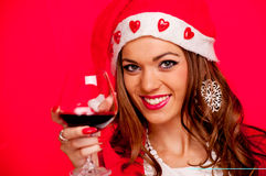 Young woman with Santa hat and red wine Stock Image