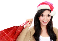 Young woman in santa hat with shopping bag royalty free stock photography