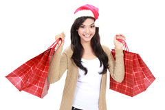 Young woman in santa hat with shopping bag stock photography