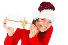 Young woman with santa hat showing a letter Royalty Free Stock Photo