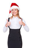 Young woman in santa hat showing thumbs up Stock Photography