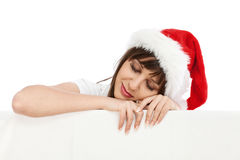 Young woman with santa hat sleeping Stock Photos
