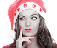 Young woman with Santa hat thinking Stock Photos