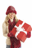 Young woman with Santa with holding present Stock Image