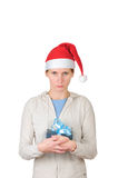 Young woman in santa's hat holding gift box Royalty Free Stock Images