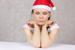 Young woman in Santas hat Stock Photography