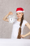 Young woman in Santas hat Royalty Free Stock Image