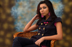 Young woman sat in chair Stock Image