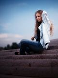 Young woman sat on steps Royalty Free Stock Image