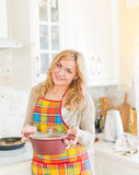 Young woman with sauce pan Royalty Free Stock Photo