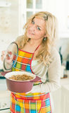 Young woman with sauce pan Stock Photo