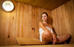 Young woman  in a sauna Royalty Free Stock Photos