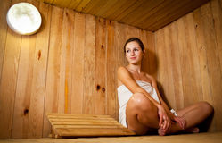 Young woman  in a sauna Stock Images