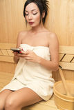 Young woman in sauna Stock Image