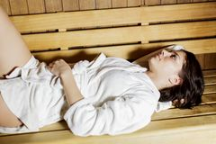 Young woman in the sauna Stock Photos