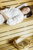Young woman in the sauna Stock Photo