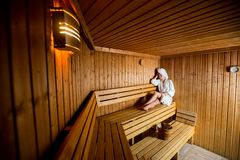 Young woman in the sauna Stock Images