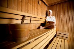 Young woman in the sauna Royalty Free Stock Image
