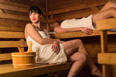Young woman in a sauna Stock Photo