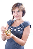 Young woman saving money.  Royalty Free Stock Photography