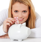 Young woman saving money Royalty Free Stock Image