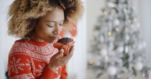 Young woman savoring a Christmas cake Royalty Free Stock Photography