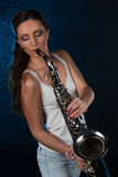 Young woman with a saxophone Stock Photos