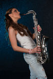 Young woman with a saxophone Royalty Free Stock Images