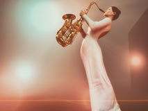 Young woman with saxophone Stock Photo
