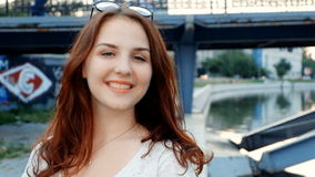 Young woman say hi for social media like vlog. Young redhead smiling happy in sunny outdoors stock video footage