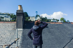 Young woman on scaffolding by roof Royalty Free Stock Images