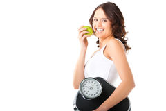 Young woman with scale under her arm and apple Stock Photos