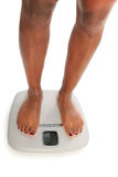 Young Woman on Scales Stock Images