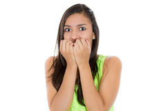 Young woman scared and afraid with wide opened eyes Stock Image