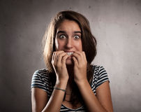 Young woman scared Stock Images