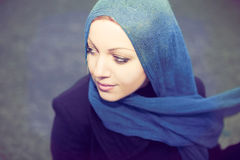 Young woman in  scarf. Young woman in blue  scarf Royalty Free Stock Photos