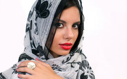 Young woman with scarf. Beautiful young woman with scarf on the head isolated on white background Royalty Free Stock Images