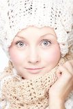 Young woman in scarf. Young woman in knitted scarf and hat Stock Photo