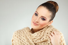 Young woman with a scarf around the neck Royalty Free Stock Photo