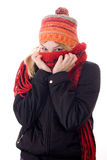 Young woman in scarf and cap. Winter portrait of a beautiful young woman with a cap and a scarf. Studio shot white background stock photography