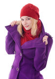 Young woman in scarf and cap Royalty Free Stock Images