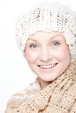 Young woman in scarf smiling. Cheerful young woman in knitted scarf and hat Royalty Free Stock Image