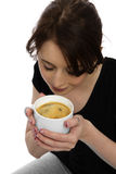Young woman scenting coffee Royalty Free Stock Photography