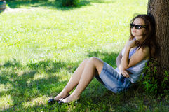 Young woman school girl sitting outdoors Royalty Free Stock Image