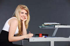 Young woman with schoolwork Stock Photography