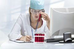 Young woman scientist examining a test tube Stock Image