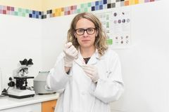 Young woman scientist researching in laboratory.  royalty free stock photo