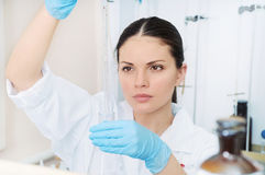 Young woman scientist working with tube at the laboratory Royalty Free Stock Photography