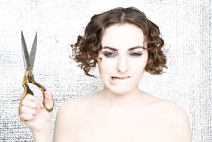 Young woman with scissors Stock Photos